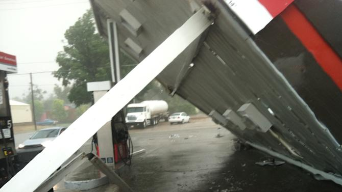 This photo provided by Mark Sarlo shows damage to a gas station after severe weather passed through the area on Monday, June 17, 2013 in La Junta, Colo.   National Weather Service spokeswoman Nezette Rydell said the tornado knocked down power poles in an industrial park near La Junta on Monday, but no injuries have been reported. More storms are expected on Tuesday. La Junta Fire Chief Aaron Eveatt said high winds raked the city, knocking down power poles in town and forcing the closure of a U.S. Highway 50, a main highway.  (AP Photo/Mark Sarlo)