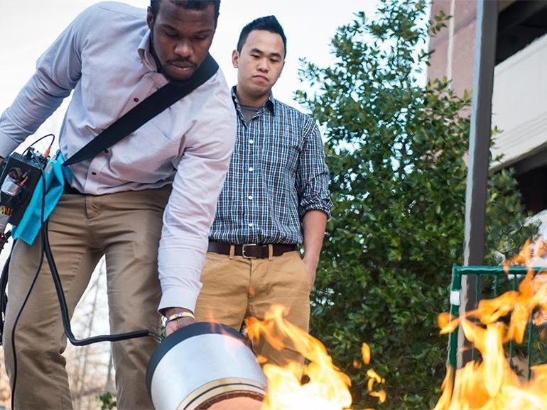 Engineering students extinguish fire with sound