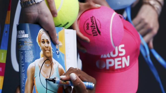 Williams of the U.S. signs autographs after defeating compatriot Keys in their women's singles semi-final match at the Australian Open 2015 tennis tournament in Melbourne