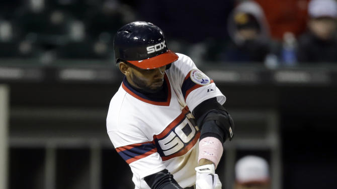 Chicago White Sox's Alexei Ramirez hits a two-run double during the seventh inning of a baseball game against the Los Angeles Angels in Chicago, Sunday, May 12, 2013. (AP Photo/Nam Y. Huh)