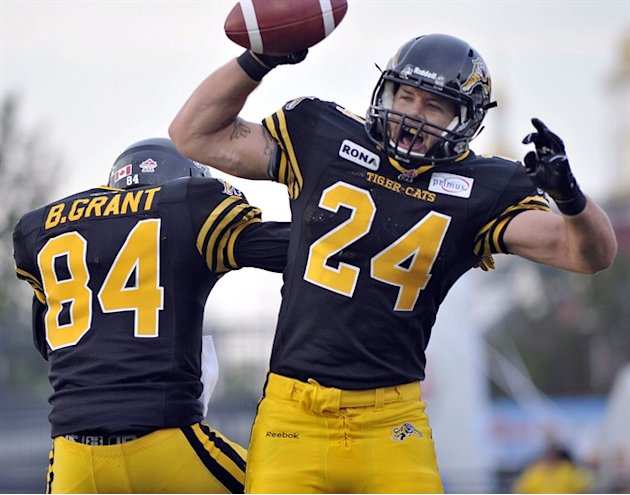 Hamilton Tiger-Cats' Daryl Stephenson, right, celebrates his touchdown with teammate Bakari Grant against the Montreal Alouettes during CFL football action in Hamilton, Ont., on July 21, 2012. It didn