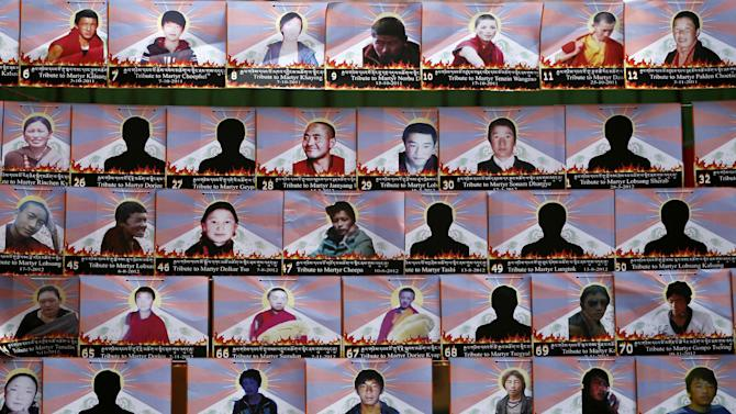 Photographs of Tibetans who have allegedly self-immolated themselves in protest against Chinese rule, hang from a wire during a rally to mark World Human Rights Day in New Delhi, Monday, Dec. 10, 2012. At least 86 people have set themselves on fire since 2009. The Nobel Peace Prize is also awarded each year on Dec. 10, which the Dalai Lama was awarded in 1989. (AP Photo/Mustafa Quraishi)