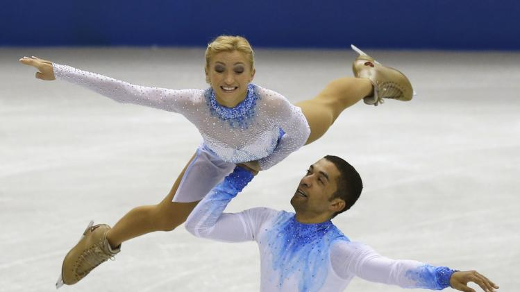 Savchenko and Szolkowy of Germany perform during the pairs short programme at the ISU Grand Prix of Figure Skating Final in Fukuoka