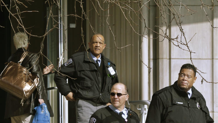 Security guards keep watch at the front entrance to the Western Psychiatric Institute and Clinic on the University of Pittsburgh campus on Friday, March 9, 2012 in Pittsburgh. A gunman opened fire after entering the lobby of the psychiatric hospital on Thursday, March 8, 2012. Two people, including the gunman, were killed and seven others wounded. (AP Photo/Keith Srakocic)