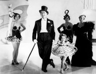 "FILE - This undated file photo shows six-year-old Shirley Temple as she appears in her first featured role in the 1934 musical ""Stand Up and Cheer"" with James Dunn. (AP Photo, File)"