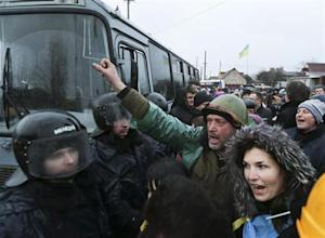 Police block pro-European integration supporters as they stage a rally near the residence of Ukraine's President Yanukovich outside Kiev