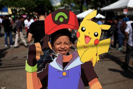 """A fan of the augmented reality mobile game """"Pokemon Go"""" by Nintendo participate in a """"poketour"""" organized by the municipality in San Salvador"""