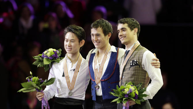 First place winner of the men's free skate Patrick Chan of Canada, center, poses with second-placed Denis Ten of Kazakhstan, left, and third-placed Javier Fernandez of Spain at the World Figure Skating Championships Friday, March 15, 2013, in London, Ontario. (AP Photo/Darron Cummings)