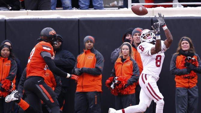Bell's late TD pass lifts OU over OSU 33-24