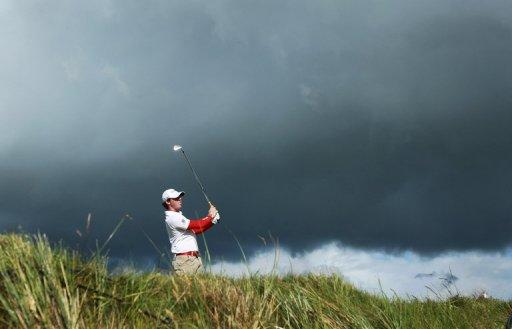 Northern Irish golfer Rory McIlroy drives from the fourteenth tee