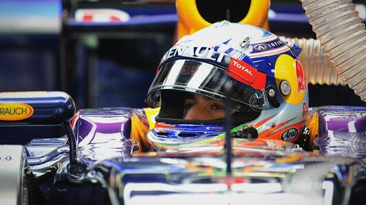 Red Bull driver Daniel Ricciardo of Australia prepares to drive in the pits during the Formula One Chinese Grand Prix in Shanghai on April 18, 2014