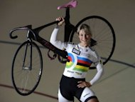 German track cyclist Kristina Vogel, pictured in May 2012, poses for a portrait at a cycling track in Erfurt, eastern Germany. Three years after surviving an horrific accident, Vogel will arrive at the London Olympic Games 2012 as the world team sprint champion and record holder
