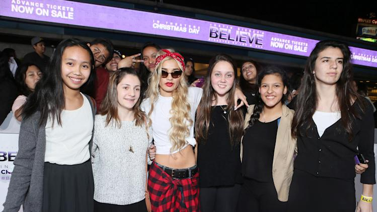 "Pia Mia and guests seen at the World Premiere of Open Road's ""Justin Bieber's Believe"" presented by Teen Vogue and sponsored by Clearasil, on Wednesday, Dec. 18, 2013 in Los Angeles. (Photo by Alexandra Wyman/Invision for Open Road Films/AP Images)"