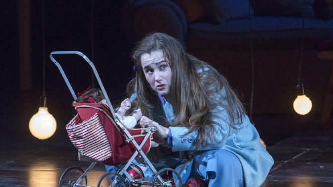 """In this Feb. 22, 2013 photo provided by the New York City Opera, Lauren Worsham performs in the role of Flora during a dress rehearsal of """"The Turn of the Screw,"""" by the New York City Opera at the Brooklyn Academy of Music in New York. (AP Photo/New York City Opera, Richard Termine)"""