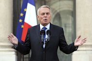 French Prime Minister Jean-Marc Ayrault delivers a speech after the weekly cabinet meeting on September 28. France has unveiled action to plug a 37-billion-euro hole in its public finances with the toughest package of tax rises and spending cuts the country has known in an economic downturn