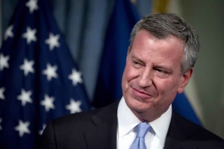 New York City Mayor Bill de Blasio attends a news conference to announce a tentative contract agreement with the Uniformed Superior Officers Coalition at City Hall in New York