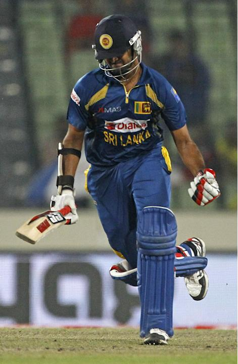 Sri Lanka's Lahiru Thirimanne celebrates after scoring a century during the Asia Cup final cricket match between Sri Lanka and Pakistan in Dhaka, Bangladesh, Saturday, March 8, 2014. (AP Photo/A.M. Ah