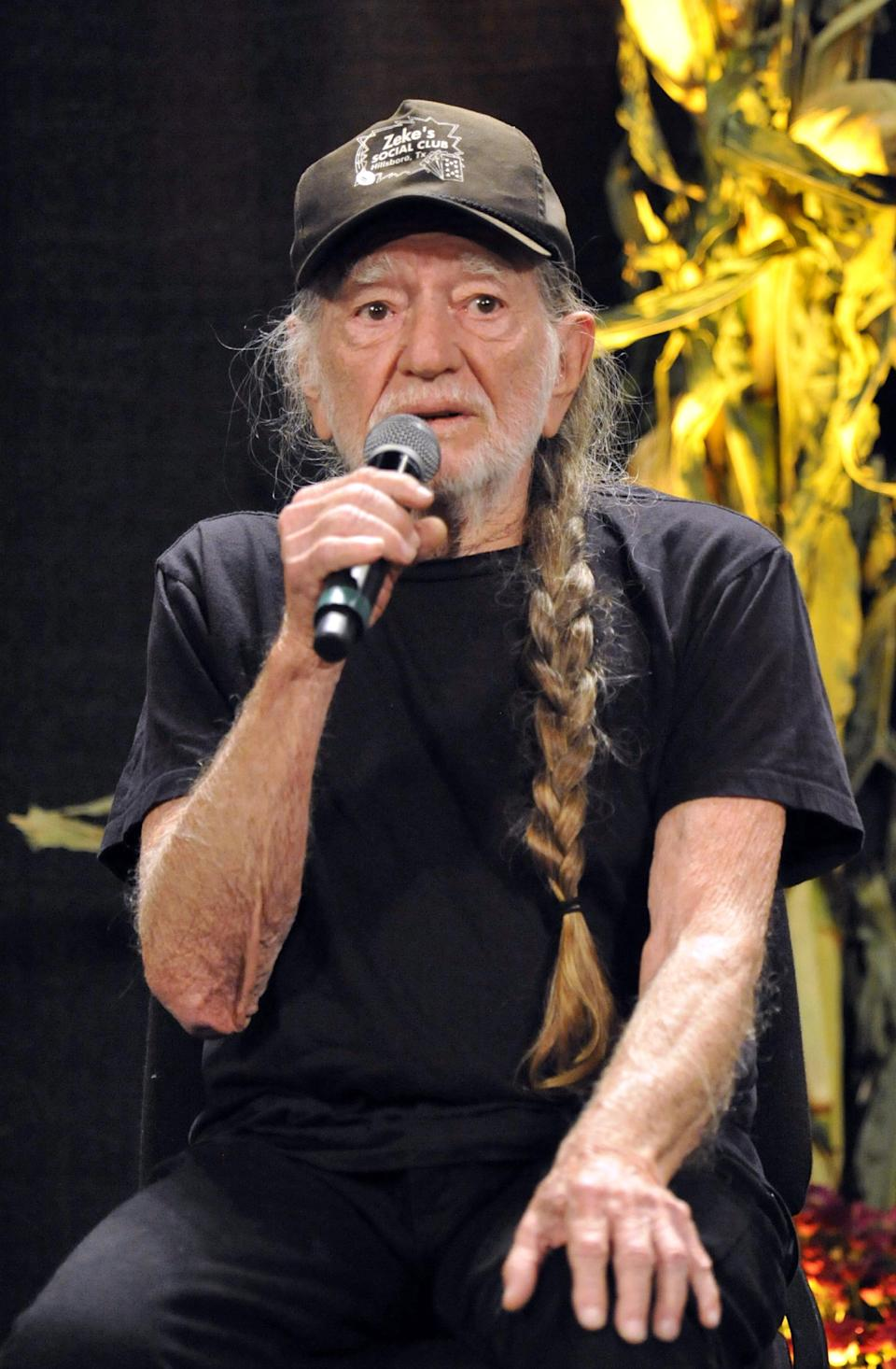 Willie Nelson talks with reporters during a news conference prior to the start of the Farm Aid 2013 concert at Saratoga Performing Arts Center in Saratoga Springs, N.Y., Saturday, Sept. 21, 2013. (AP Photo/Hans Pennink)