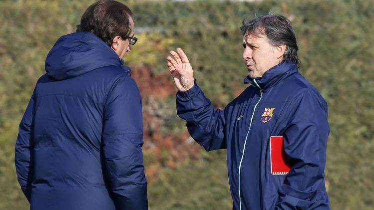 FC Barcelona's coach Martino gestures to his assistant during a training session at Ciutat Esportiva Joan Gamper in Sant Joan Despi