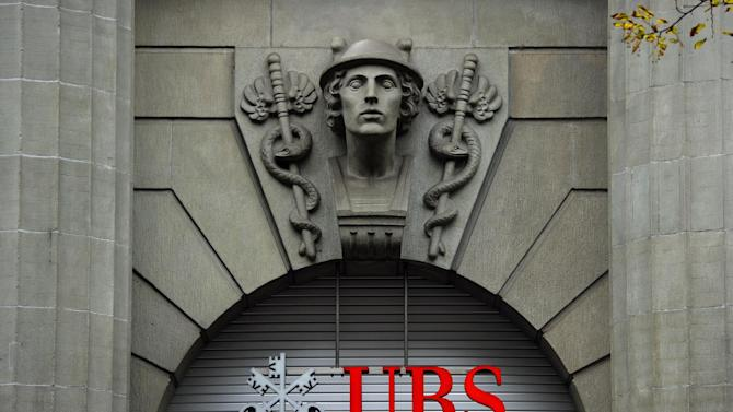 The logo of the Swiss banking giant UBS is seen above its headquarters in downtown Zurich on October 15, 2011