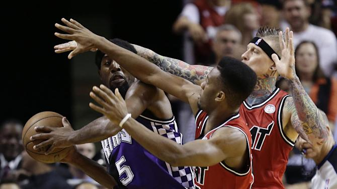 Miami Heat's Norris Cole, center, and Chris Andersen pressure Sacramento Kings' John Salmons (5) during the first half of an NBA basketball game in Miami, Tuesday, Feb. 26, 2013. (AP Photo/J Pat Carter)