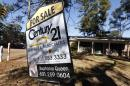 FILE - In this Jan. 8, 2015 file photo, a realty sign is posted in front of a home for sale in Jackson, Miss. Freddie Mac reports on average U.S. mortgage rates on Thursday, April 9, 2015. (AP Photo/Rogelio V. Solis, File)