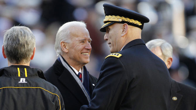 Vice President Joe Biden visits with Army Gen. Ray Odierno, center right, before the start of the 112th edition of the annual Army vs. Navy NCAA college football game at FedEx Field in Landover, Md., Saturday, Dec. 10, 2011. (AP Photo/Evan Vucci)