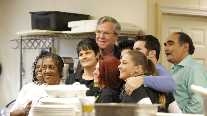 U.S. Republican presidential candidate Jeb Bush takes a photo with the kitchen staff following a campaign event in Florence