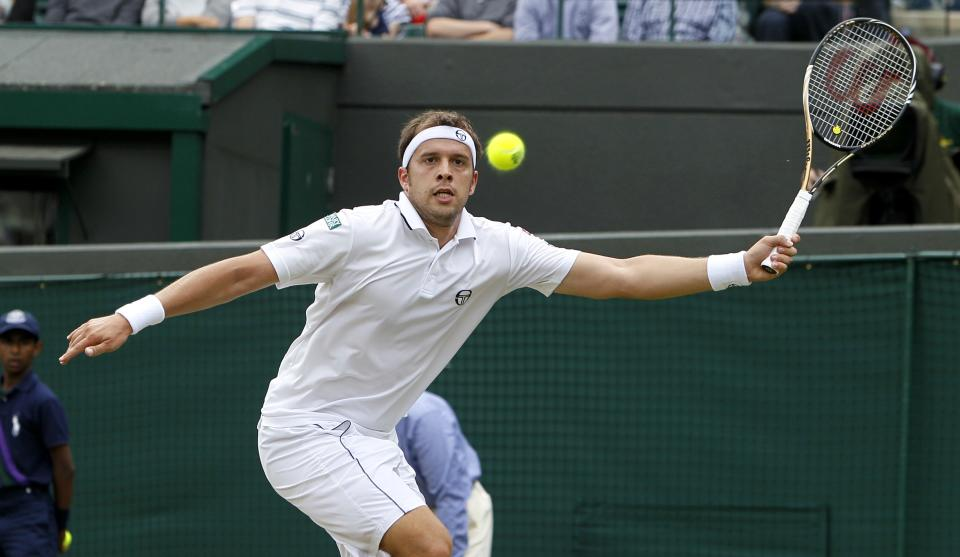 Luxembourg's Gilles Muller returns a shot to Spain's Rafael Nadal during their match at the All England Lawn Tennis Championships at Wimbledon, Saturday, June 25, 2011. (AP Photo/Alastair Grant)