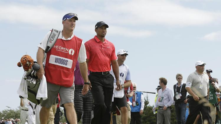 Tiger Woods of the United States walks to the fourth tee with his caddie Joe LaCava at Royal Lytham & St Annes golf club during the final round of the British Open Golf Championship, Lytham St Annes, England Sunday, July  22, 2012. (AP Photo/Jon Super)