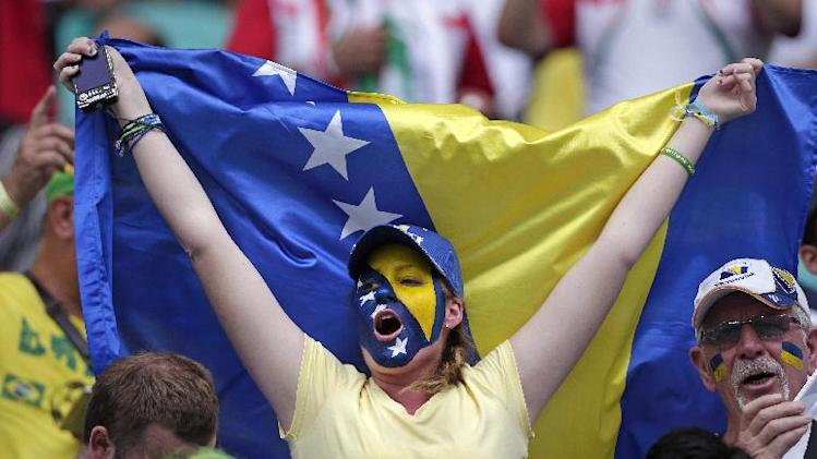 Bosnia's fans cheer for their team during the group F World Cup soccer match between Bosnia and Iran at the Arena Fonte Nova in Salvador, Brazil, Wednesday, June 25, 2014. (AP Photo/Marcio Jose Sanchez)