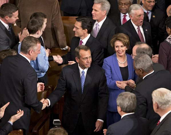 House Speaker John Boehner of Ohio, enters the House of Representatives chamber, on Capitol Hill in Washington, Thursday, Jan. 3, 2013, after surviving a roll call vote in the newly convened 113th Congress. He is escorted by House Majority Leader Eric Cantor of Va., House Minority Leader Nancy Pelosi of Calif., House Majority Whip Kevin McCarthy of Calif., and House Minority Whip Steny Hoyer of Md. (AP Photo/J. Scott Applewhite)