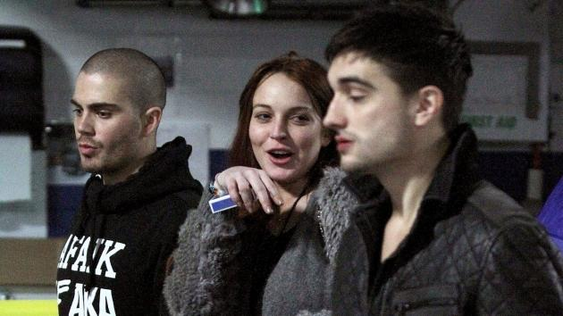 Max George of The Wanted, Lindsay Lohan and Tom Parker of The Wanted walk backstage at KISS 108 Jingle Ball 2012 at TD Garden on December 6, 2012 in Boston -- Getty Premium