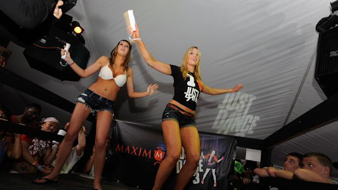 From left, Erin Moorhous of Arcadia, Ind. and Katrina Bowden face off in the Just Dance 3 challenge at the Maxim Just Dance 3 Spring Break party at Hammerhead Fred's in Panama City Beach Fla., Thursday, March 8, 2012. Bowden, Maxim's February 2012 cover girl is on the show 30 Rock and in the movies American Reunion, Piranha 3DD and Nurse 3D.  (Michael Spooneybarger/ AP Images for Ubisoft)