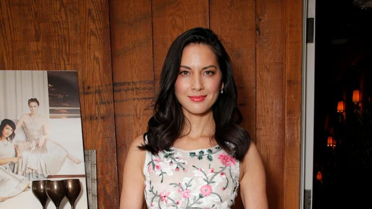 Olivia Munn attends The Hollywood Reporter & Jimmy Choo Celebration of the Most Powerful Stylists in Hollywood, on Wednesday, March 12, 2014, in West Hollywood, Calif. (Photo by Todd Williamson/Invision for The Hollywood Reporter/AP Images)