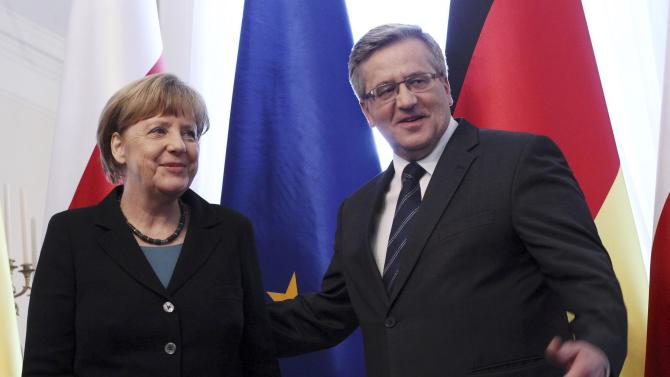 Poland's President Komorowski greets German Chancellor Merkel after a meeting for Polish-German government consultations in Warsaw