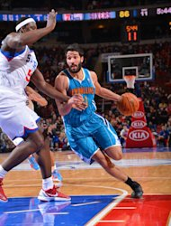 PHILADELPHIA, PA - JANUARY 15: Greivis Vasquez #21 of the New Orleans Hornets drives to the basket against Kwame Brown #54 of the Philadelphia 76ers during the game at the Wells Fargo Center on January 15, 2013  in Philadelphia, Pennsylvania. (Photo by Jesse D. Garrabrant/NBAE via Getty Images)