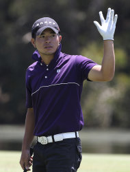 Taiwan's Chan Shih-chang reacts after playing a shot during the second round of the Australian PGA golf championship at the Hyatt Regency, Coolum, Australia, Friday, Nov. 25, 2011. (AP Photo/Tertius Pickard)