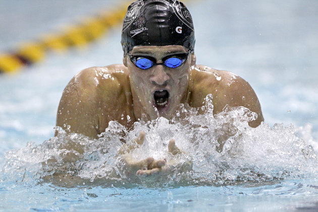 Ryan Lochte competes in the men's 200 individual medley on his way to a sixth place finish at the U.S. Winter Nationals swim meet Thursday, Dec. 1, 2011, in Atlanta. (AP Photo/David Goldman)