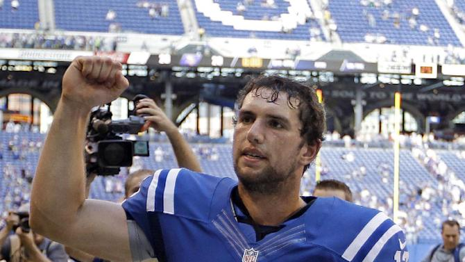 Indianapolis Colts' Andrew Luck reacts as he runs off the field after the Colts defeated the Minnesota Vikings 23-20 in an NFL football game in Indianapolis, Sunday, Sept. 16, 2012. (AP Photo/Michael Conroy)