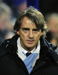 Manchester City's Italian manager Roberto Mancini looks on before the English Premier League football match between Queens Park Rangers and Manchester City at Loftus Road in London, England on January 29, 2013