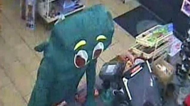 In this surveillance video taken Sept. 5, 2011 and released by the San Diego Police Dept. shows a suspect dressed like Gumby telling a convenience store clerk he is being robbed, fumbling inside the costume as if to pull a gun, dropping 27 cents and leaving. Police say the attempted robbery took place Monday Sept.5, 2011 at a 7-Eleven in Rancho Penasquitos, Calif. (AP Photo/San Diego Police Department)