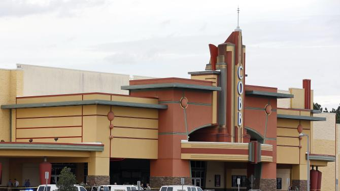 Law enforcement vehicles are parked outside the Cobb Grove 16 movie theater in Wesley Chapel, Florida