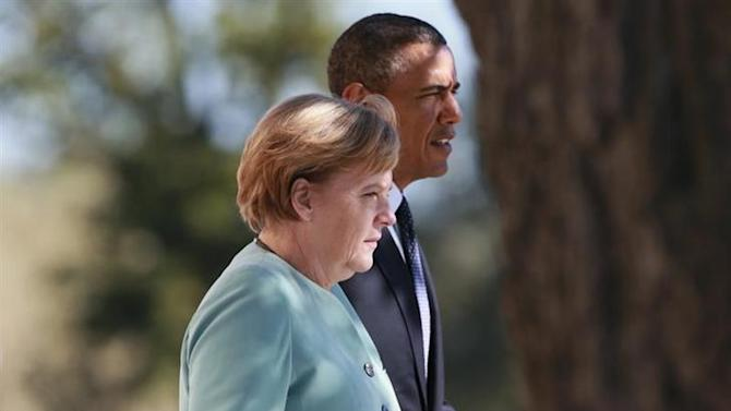 German Chancellor Angela Merkel (L) and U.S. President Barack Obama walk together during the family picture event during the G20 summit in St.Petersburg September 6, 2013. REUTERS/Anton Denisov/RIA Novosti/Pool/Files