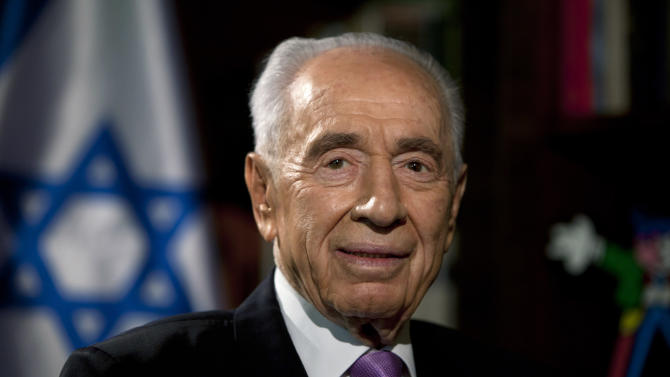 HOLD FOR STORY PERES TURNS 90 BY DAN PERRY AND JOSEF FEDERMAN - In this photo taken Sunday, June 16, 2013,  Israel's President Shimon Peres, is seen during an interview with The Associated Press at the President's residence in Jerusalem. As Shimon Peres turns 90, the indefatigable Israeli president is doing what he has always done: looking ahead, preparing for the next challenge and believing that he will see Middle East peace in his lifetime. (AP Photo/Sebastian Scheiner)