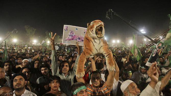 Supporters of Pakistan's former Prime Minister Nawaz Sharif, listen to him delivering a speech, during an election campaign rally, in Lahore, Pakistan, Thursday, May 9, 2013. Pakistan is scheduled to hold parliamentary elections on May 11, the first transition between democratically elected governments in a country that has experienced three military coups and constant political instability since its creation in 1947. The parliament's ability to complete its five-year term has been hailed as a significant achievement. (AP Photo/K.M. Chaudary)