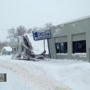 Eye Opener: Americans dig out from record storm