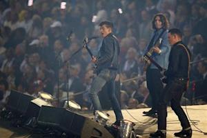 Members of the band Arctic Monkeys perform during the opening ceremony of the London 2012 Olympic Games at the Olympic Stadium