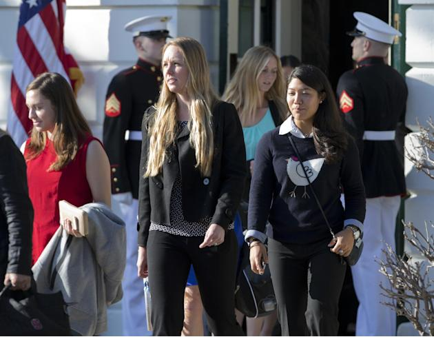Members of the Stanford University women's tennis team, walk past Marine honor guard as they join a gathering on the South Lawn of the White House in Washington, Monday, March 10, 2014, where Pres