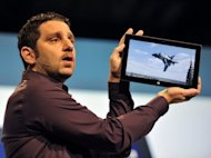 Panos Panay, the general manager of Microsoft Surface, holds up the tablet during a press conference in New York on October 25. Microsoft kicked off sales of its revamped Windows 8 system and the tablet Friday amid mixed reviews as the tech giant ramped up efforts to compete in a market shifting rapidly from PCs to mobile devices